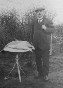 Brewer Guillaume Matthys, posing with what appears to be a large fish. From: Stroobants, Tussen pot en pint.
