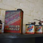 Vintage oil cans, probably used to keep the electric engine in shape.